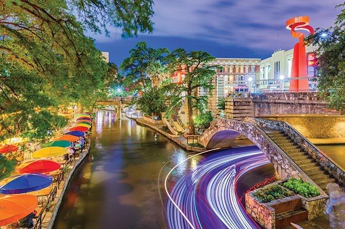 San Antonio Riverwalk at night with Torch of Friendship