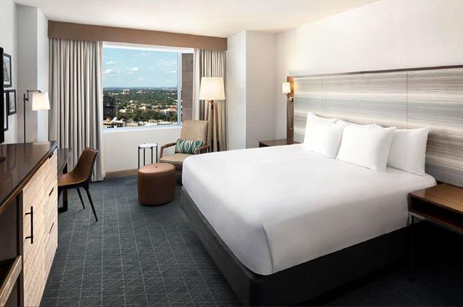 hotel room with bed, desk, chair, dresser at Grand Hyatt San Antonio