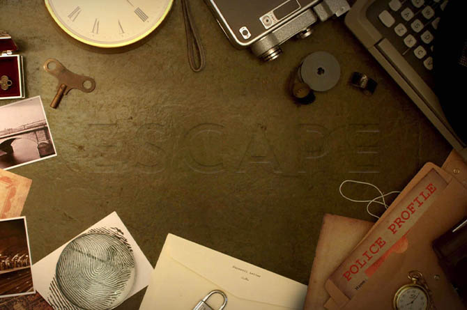 escape room items on table: clock, files, lock, key, photographs, and more